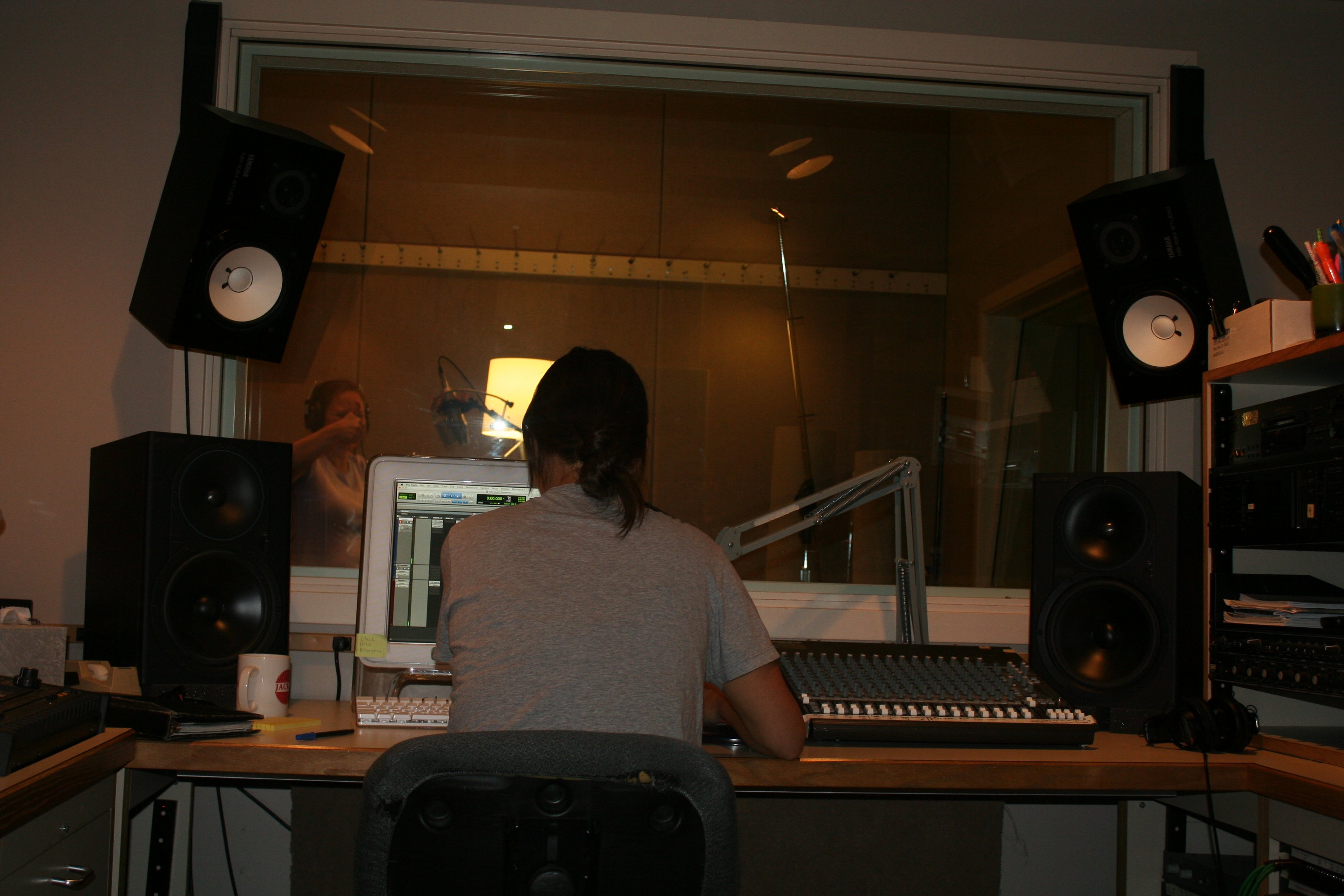 Laurie giving thumbs up at the studio recording