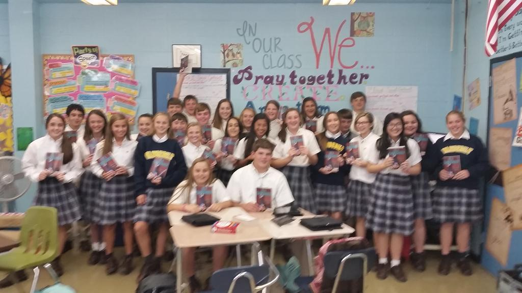 8th graders in class 1 with their new books