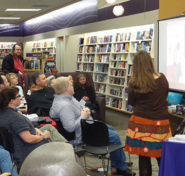 Laurie Ann Thompson speaking at a bookstore