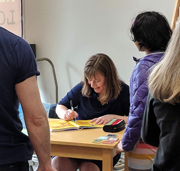 Laurie Ann Thompson signing books